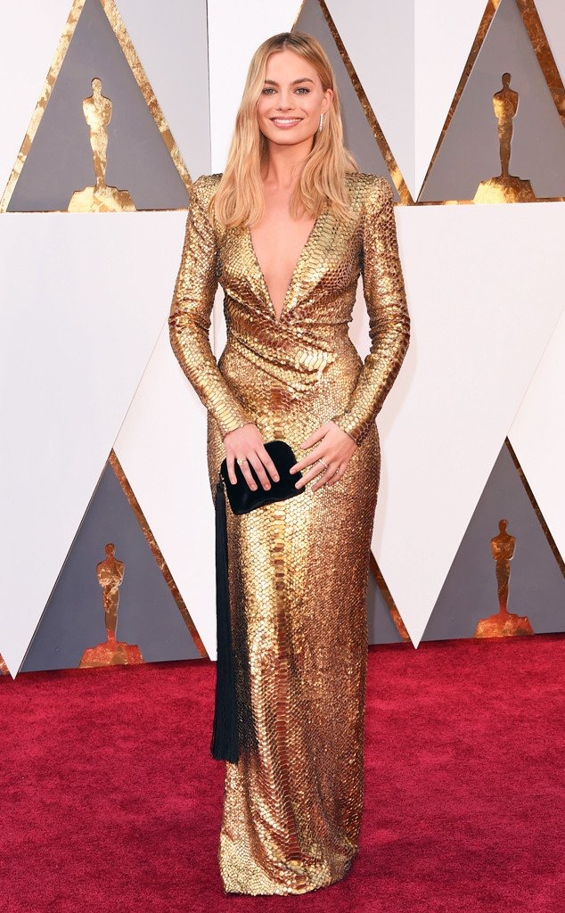 Margot Robbie- wearing a Tom Ford gown I still cannot get over that she is MY AGE!Margot reinforced my love for her when she wore this gold sequin/ snakeskin-like gown last night. Sleeves yes please!