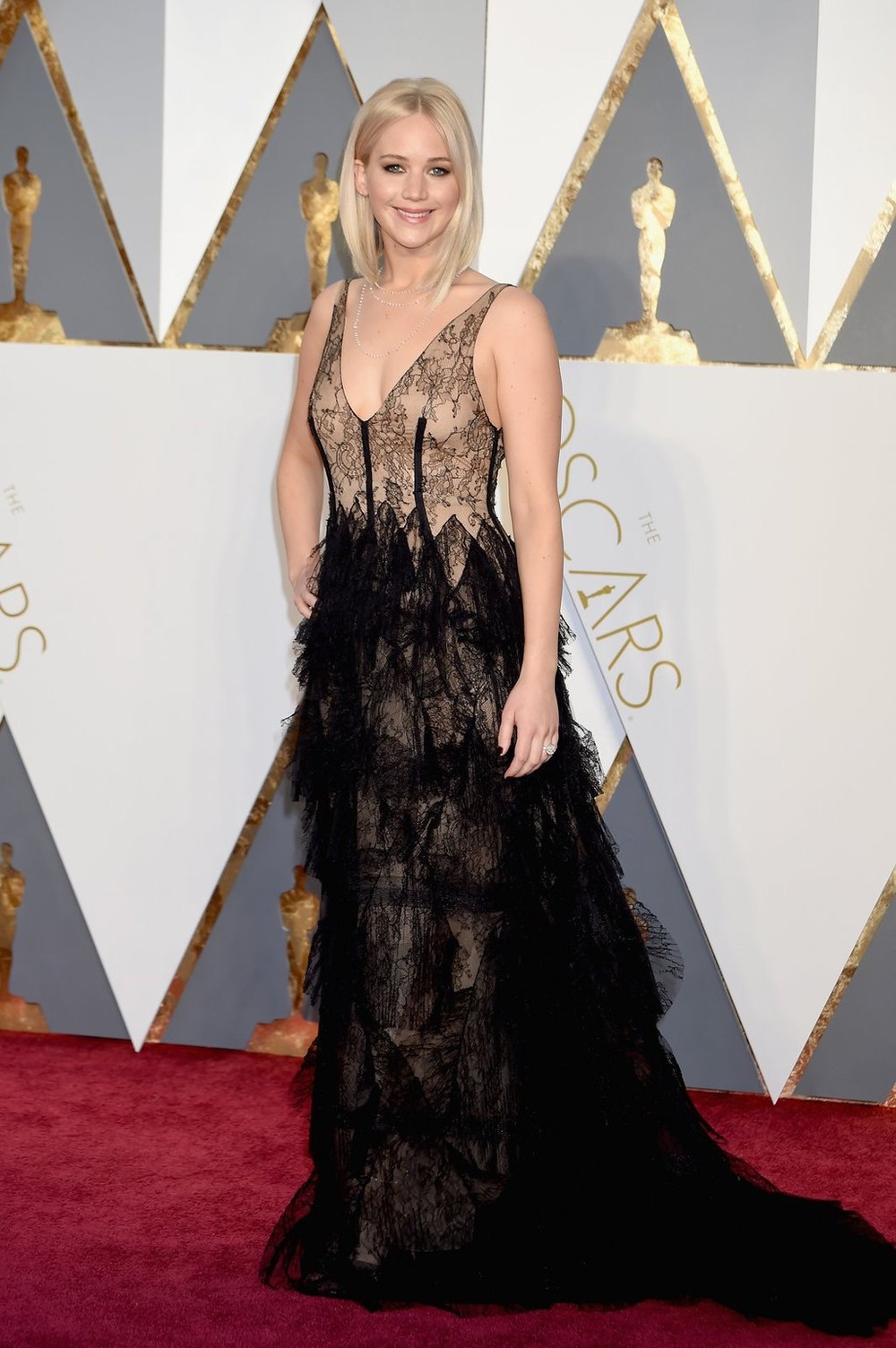 Jennifer Lawrence- wearing a Dior gown J-Law never disappoints on the red carpet. Not only am I loving her sheer gown, but her bob is everything.