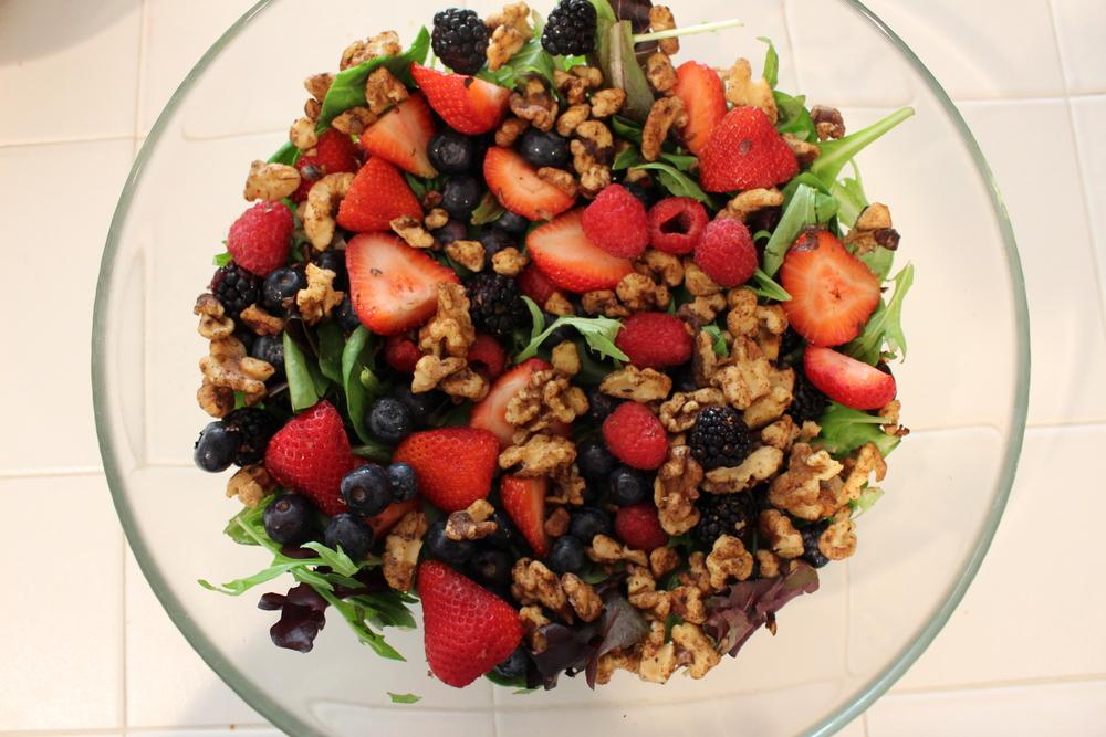 Mixed Berry Salad: Organic mixed greens, blueberries, raspberries, strawberries, blackberries, topped with homemade cinnamon toasted walnuts (no sugar)!Dressing: olive oil, balsamic vinegar, garlic, salt & pepper to taste.