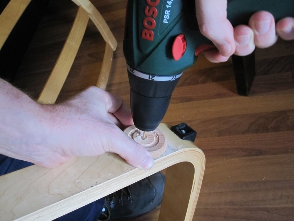 Drill the hole, using your hand as a guide