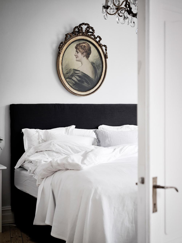 Portrait hangs above bed