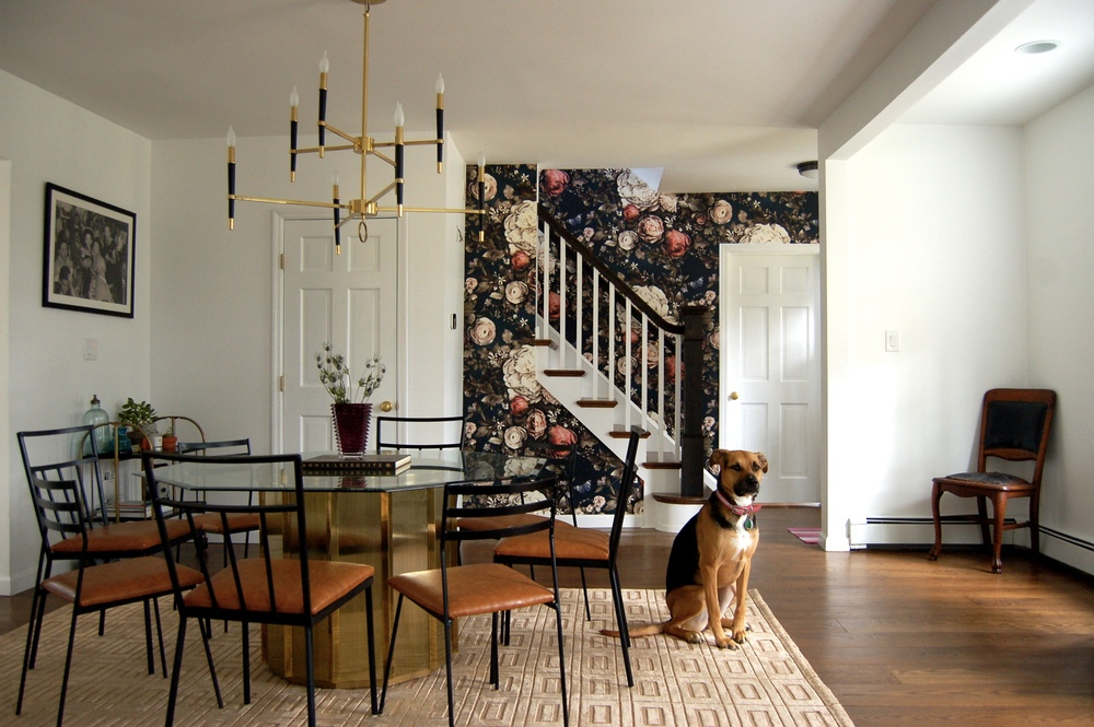 Ellie Cashman's moody floral wallpaper serves as the perfect accent for this conversation piece of a dining set: a vintage mastercraft octagonal table &  mixed vintage chairs unified with camel leather upholstery.  (And Harper proudly showing it all off!)