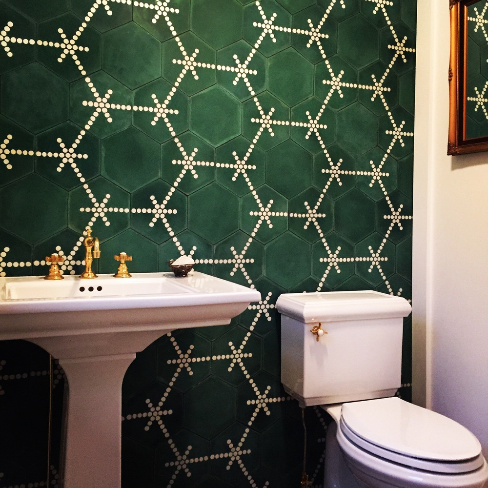 Popham Design's Hex Dot tiles in an emerald tone and Newport Brass hardware give the powder room a perfectly old + new aesthetic.