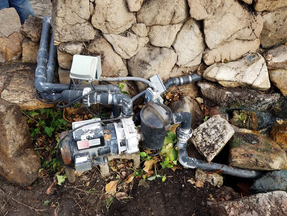 The Koi Pond pump was drawing way too much power, and was also included on the same circuit as the refrigerator, washer, and dryer (causing this circuit to trip frequently). It was replaced.