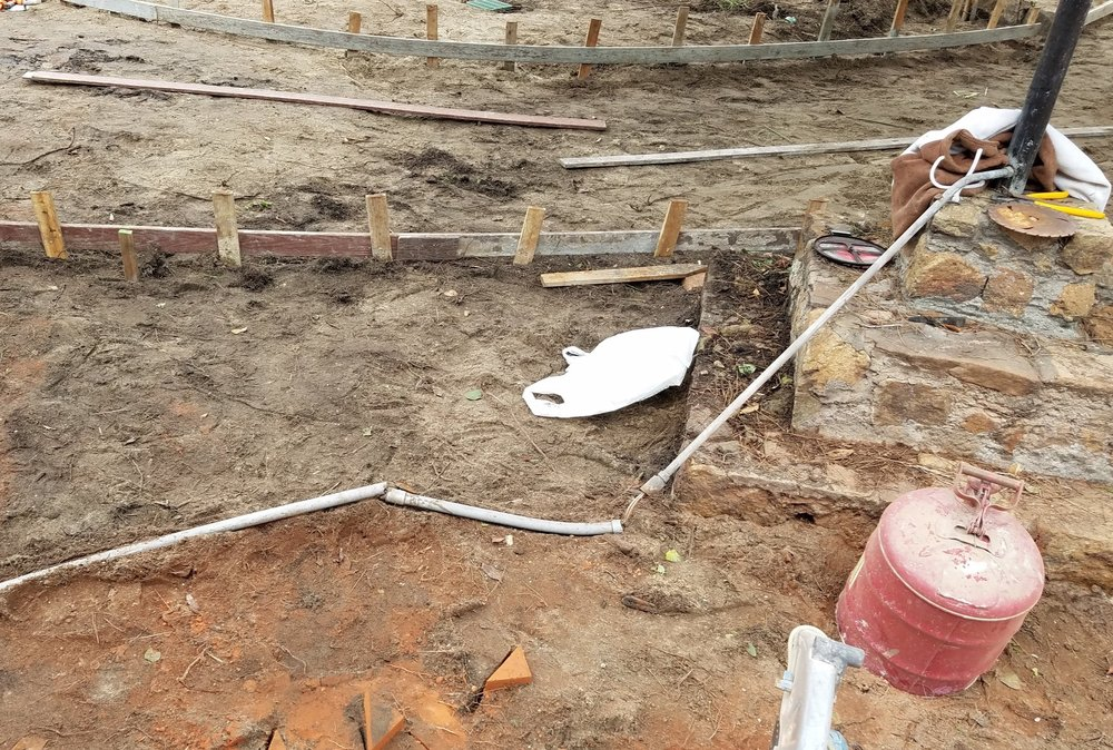 """Exposed live wires without proper conduit were found just under the surface where anyone digging could have hit them. Wires to the lantern, pond pump, and a """"surprise"""" wire near the big tree were affected. They were safely enclosed."""