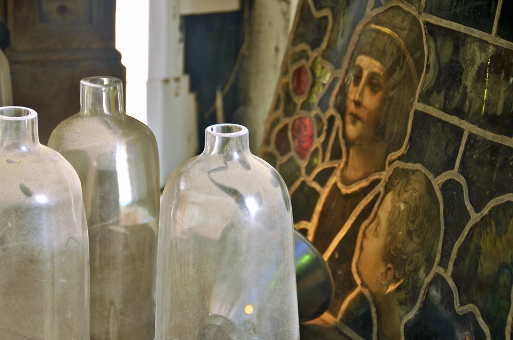 """Dusty bottles and stained glass"""