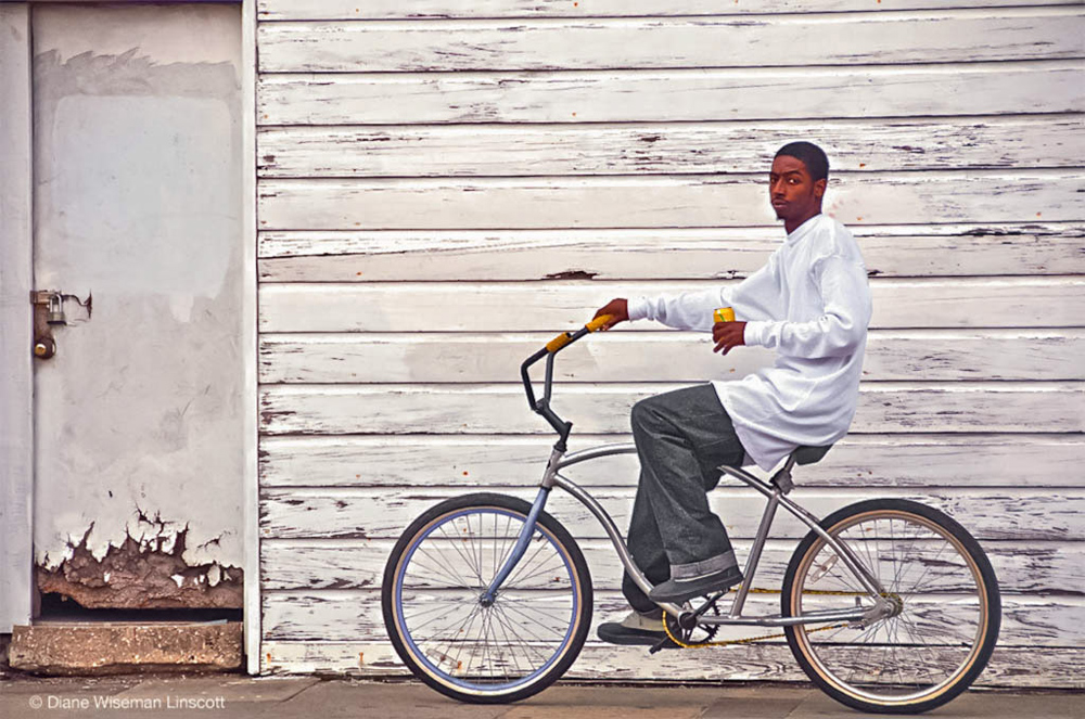 """The White Wall: Yellow can and handle bars"""
