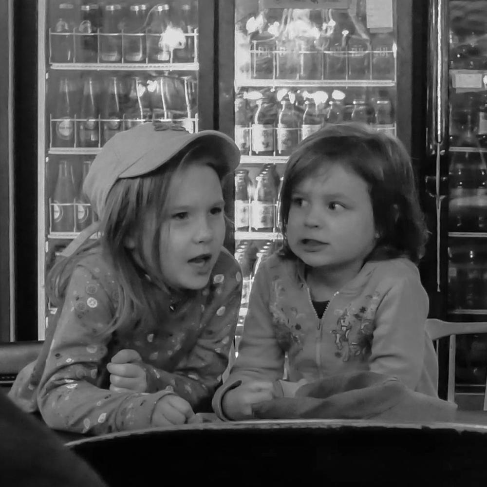 """Candid Children: Two girls sharing secrets"""