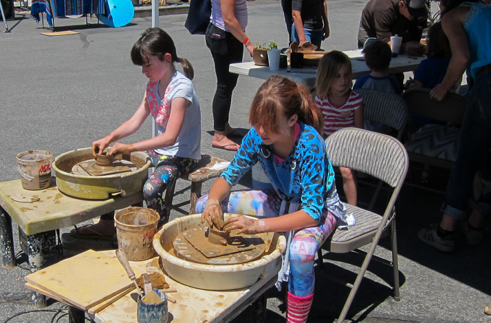 Girls focus on getting their hands dirty with the Truckee Roundhouse ceramics studio. Photo: Grant Kaye