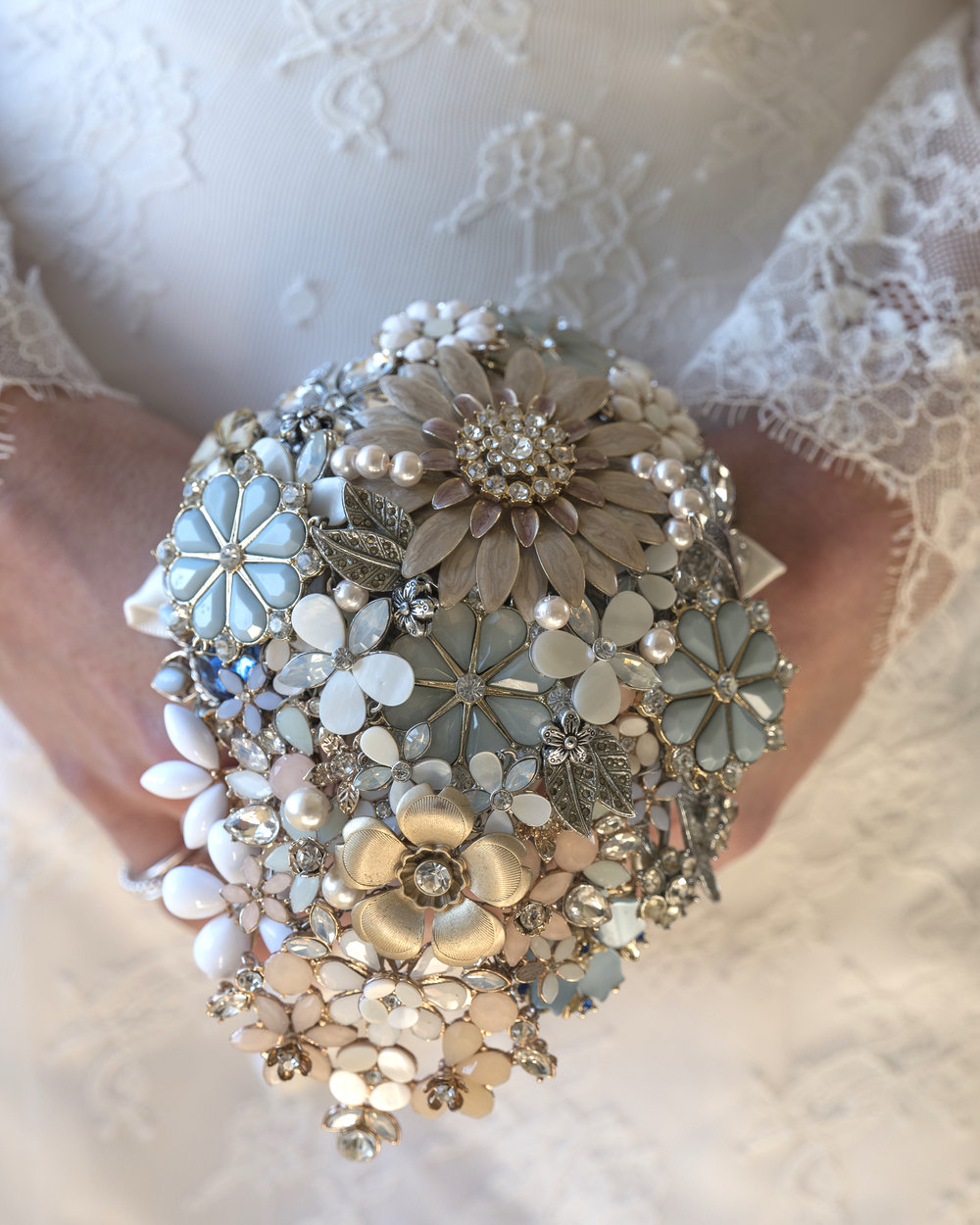 An Elsa Rose Brooch Bouquet in pastel tones, captured beautifully by  Jim Johnson