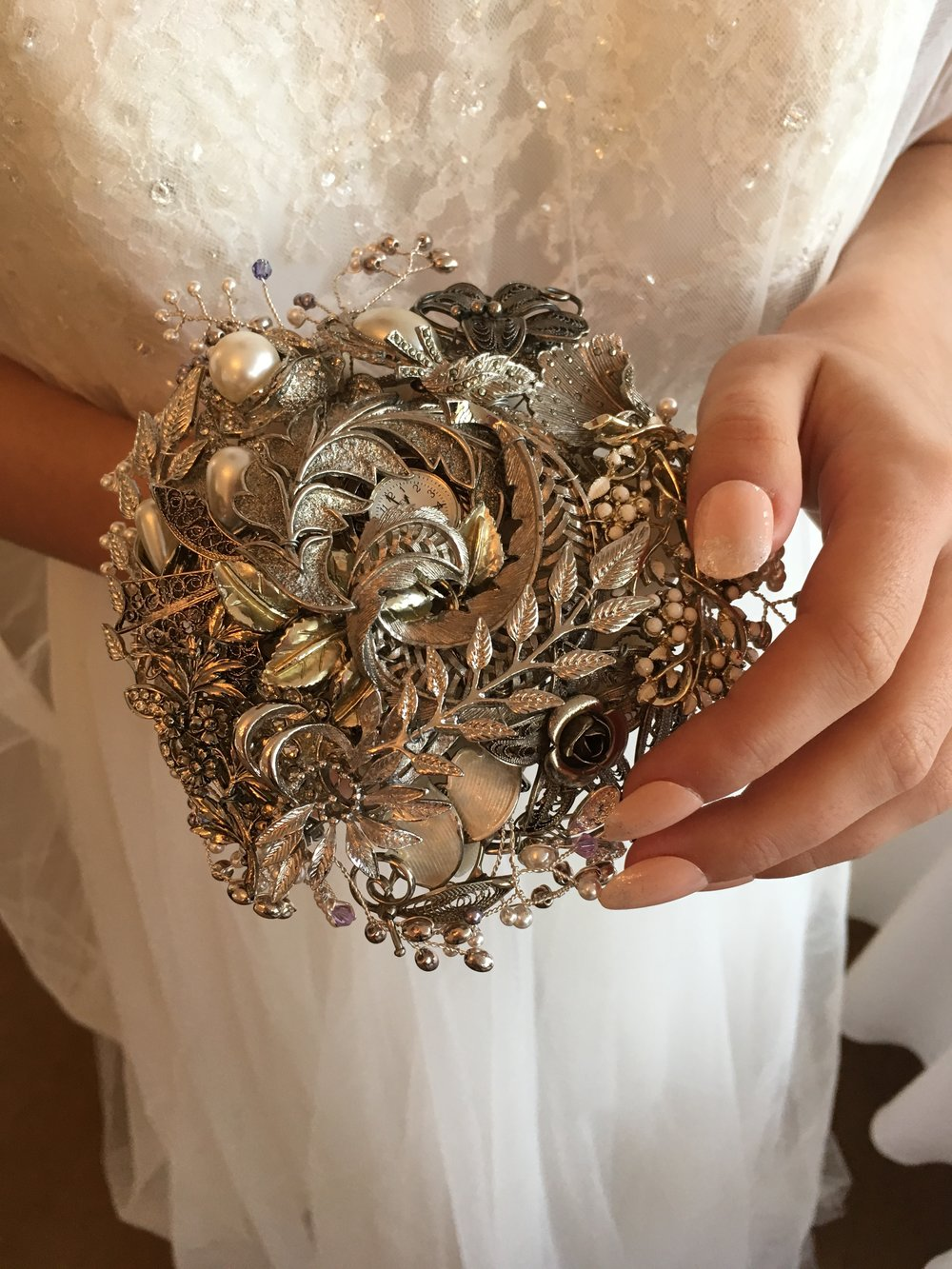 Brooch bouquet: Elsa Rose Boutique | Nails:  Marie-Louise Coster