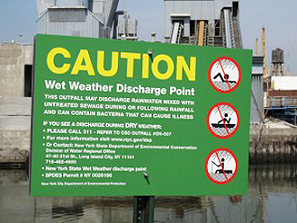 Sign posted at a combined sewer overflow in New York City to caution people not to swim, boat, or fish in the water during wet weather when raw sewage is discharged. Although raw sewage dumps are normal and accepted practice during rainfall, the New York City Department of Environmental Protection asks citizens to report any unacceptable discharge during DRY weather.  Via New York State Department of Environmental Conservation.