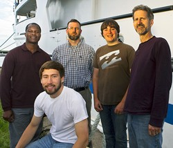 Pictured (left to right): Students Mark Omara and Adam Point, Prof. Bernie Crimmins, student Timothy Johnson and Prof. Tom Holsen during a four-day research journey exploring Lake Ontario aboard the EPA research vessel Lake Guardian.