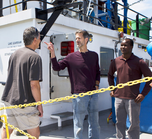 Clarkson Professor, Tom Holsen, center, and doctoral student, Mark Omara, right, talk with SUNY Fredonia Professor Mike Milligan, left, aboard the EPA research vessel, Lake Guardian.