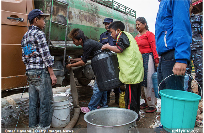 KATHMANDU, NEPAL – APRIL 28: Residents line up for water from a truck near Basantapur Durbar Square on April 28, 2015 in Kathmandu, Nepal.  gettyimages.com. used with permission