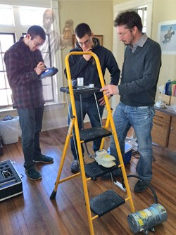 From left to right, Clarkson University undergraduate environmental engineering students Thomas M. O'Rourke '16 and Daniel C. Schwab '15 work with Associate Professor of Civil & Environmental Engineering Shane Rogers to sample air quality in buildings associated with alleged ghost activity. The researchers are studying the possible links between reported hauntings and toxic indoor molds associated with psychosis.