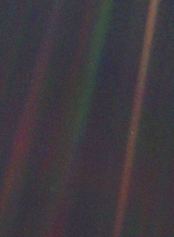 The Pale Blue Dot, part of Voyager 1's final photographic assignment which captured family portraits of the Sun and planets.Via The Planetary Society.