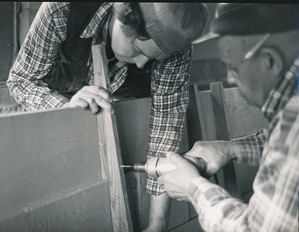 John Cronin (L) and the late Henry Gourdine build a shad boat at John's Manitou home in 1981.
