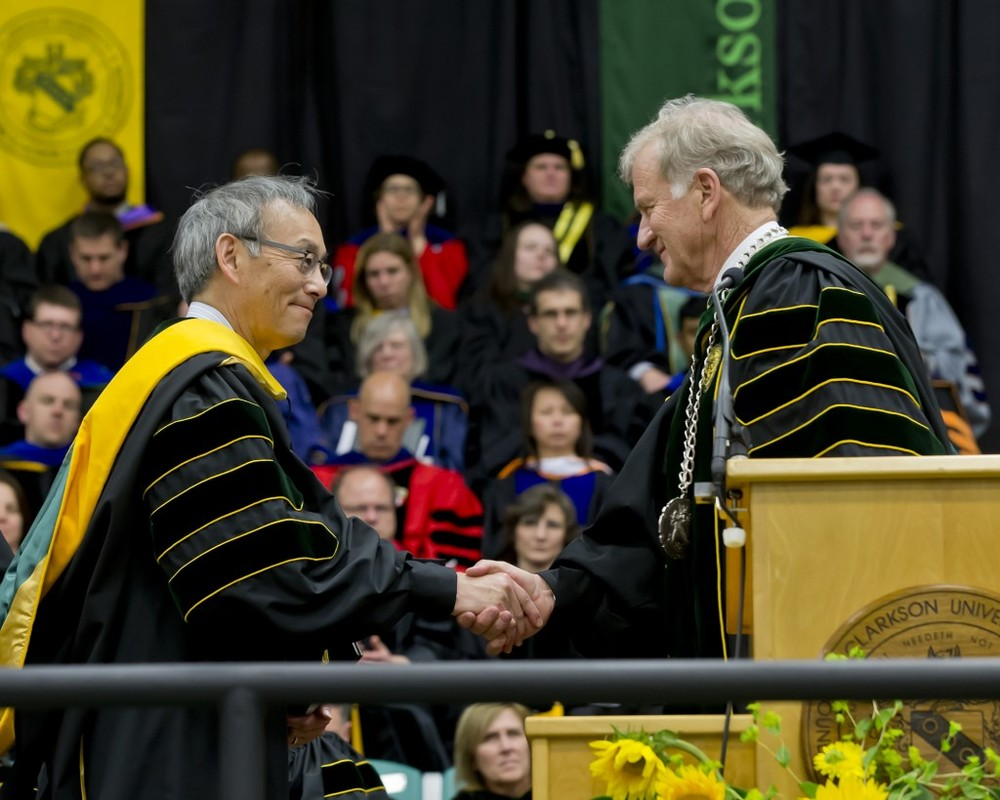Clarkson University President Tony Collins (right) congratulates Steven Chu upon receipt of his honorary degree.