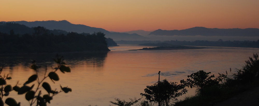 Morning over the Mekong River.   Via Wikimedia Commons.