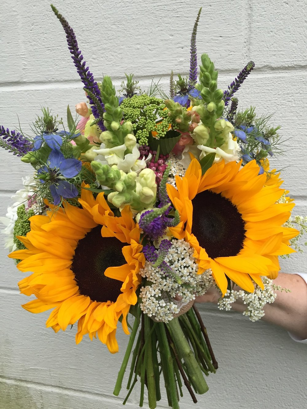 Katie's bouquet—snapdragon, yarrow, love-in-a-mist, salvia, viburnum, sunflower