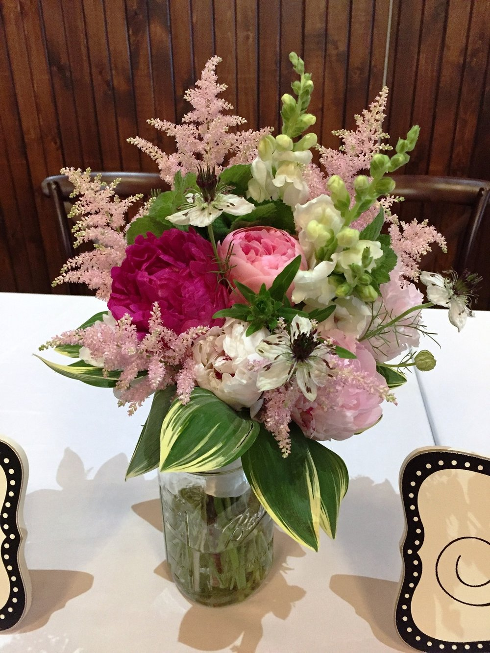 Astilbe, snapdragon, peony, love-in-a-mist, variegated solomon seal