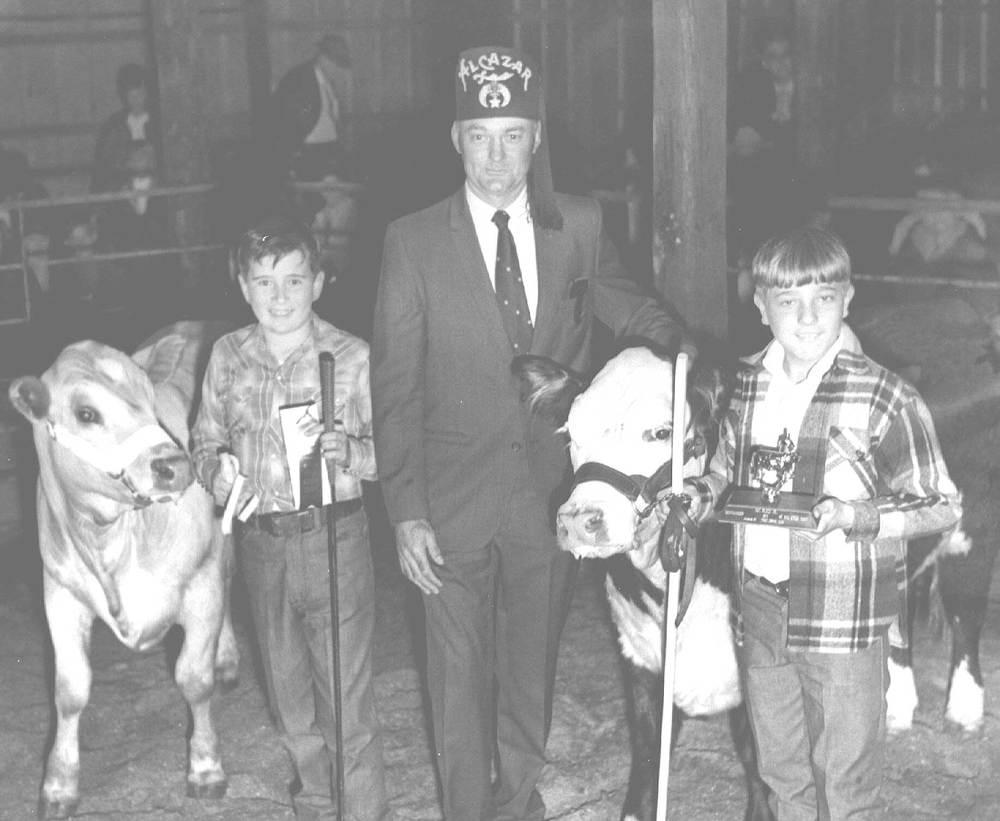 Boys with show livestock