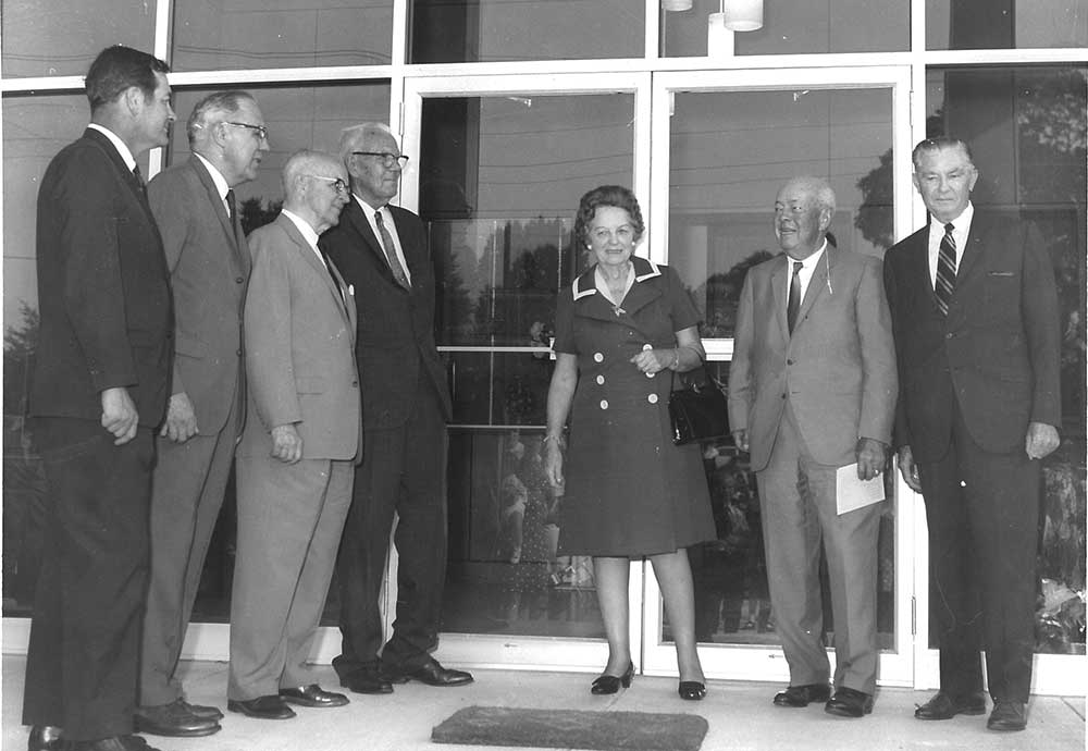 Dedication of new administration building, featuring (L to R) Troy Chamber of Commerce Pres. John Gibson, Hobson Shirey, Frank Spain, Leo Bashinsky (building donor), Mrs. Yetta Samford, Frank P. Samford (for whom Samford University is named), and Roy E. Jeffcoat, ABCH trustee