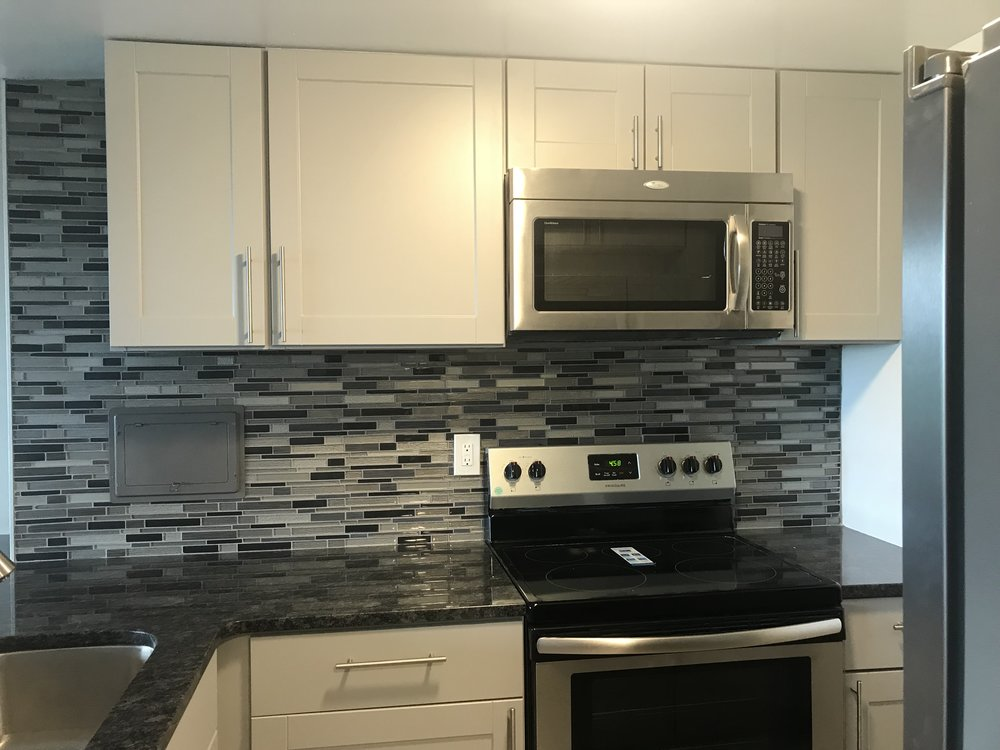 Kitchen in my condo. I love the backsplash!