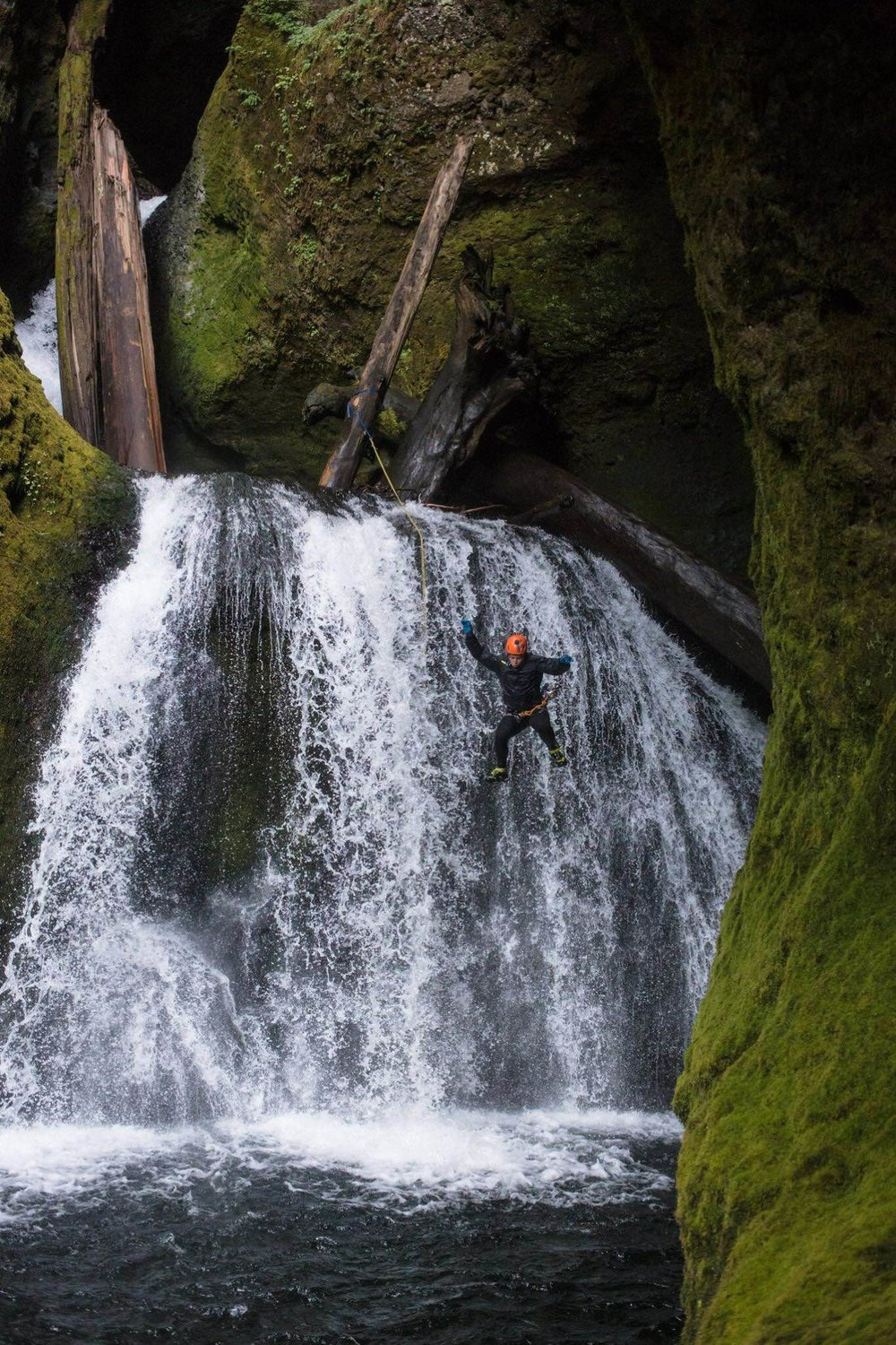 Taking a leap into a pool on a canyon trip in Southwest Washington. Photo by Jeff Bartlett.