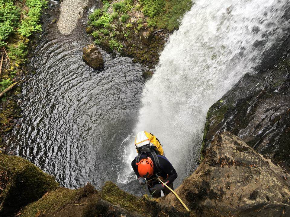 Rappelling next to a beautiful waterfall in southwest Washington. Photo by Tabbatha Cavendish.