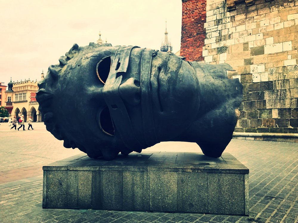 """The Head"" - Eros Bendato (Eros Bound); western corner market square Krakow, Poland."