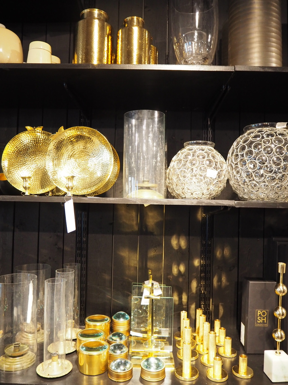 Brass candle sticks and vases at Posh Living, Stockholm.