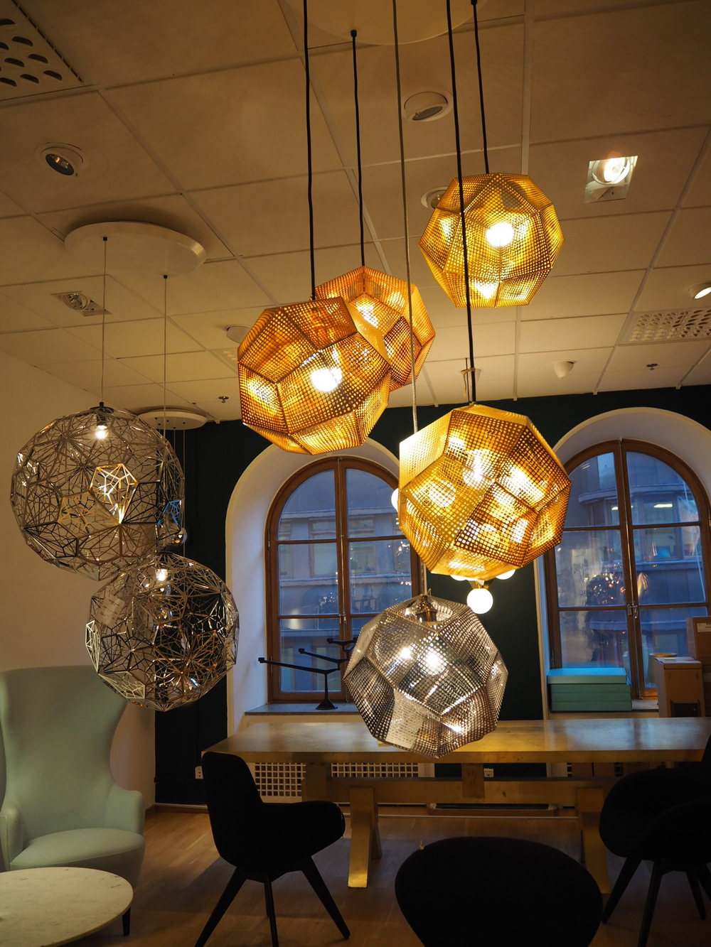 Brass and Silver pendant lights at NK, Stockholm.