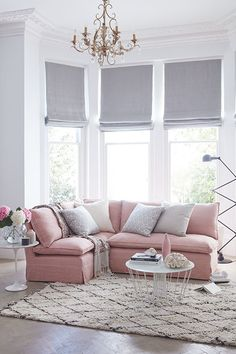 Pink sofa and white walls