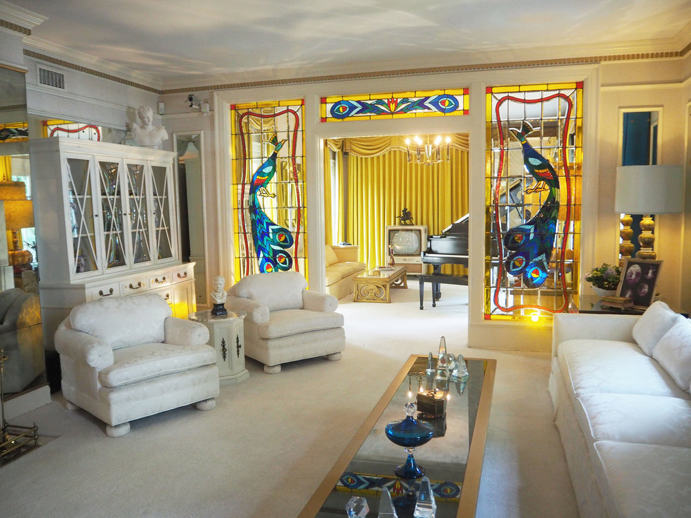 The living room inside Graceland {Elvis Presley's home, in Memphis Tennessee}. To read more and see more pics, click here.