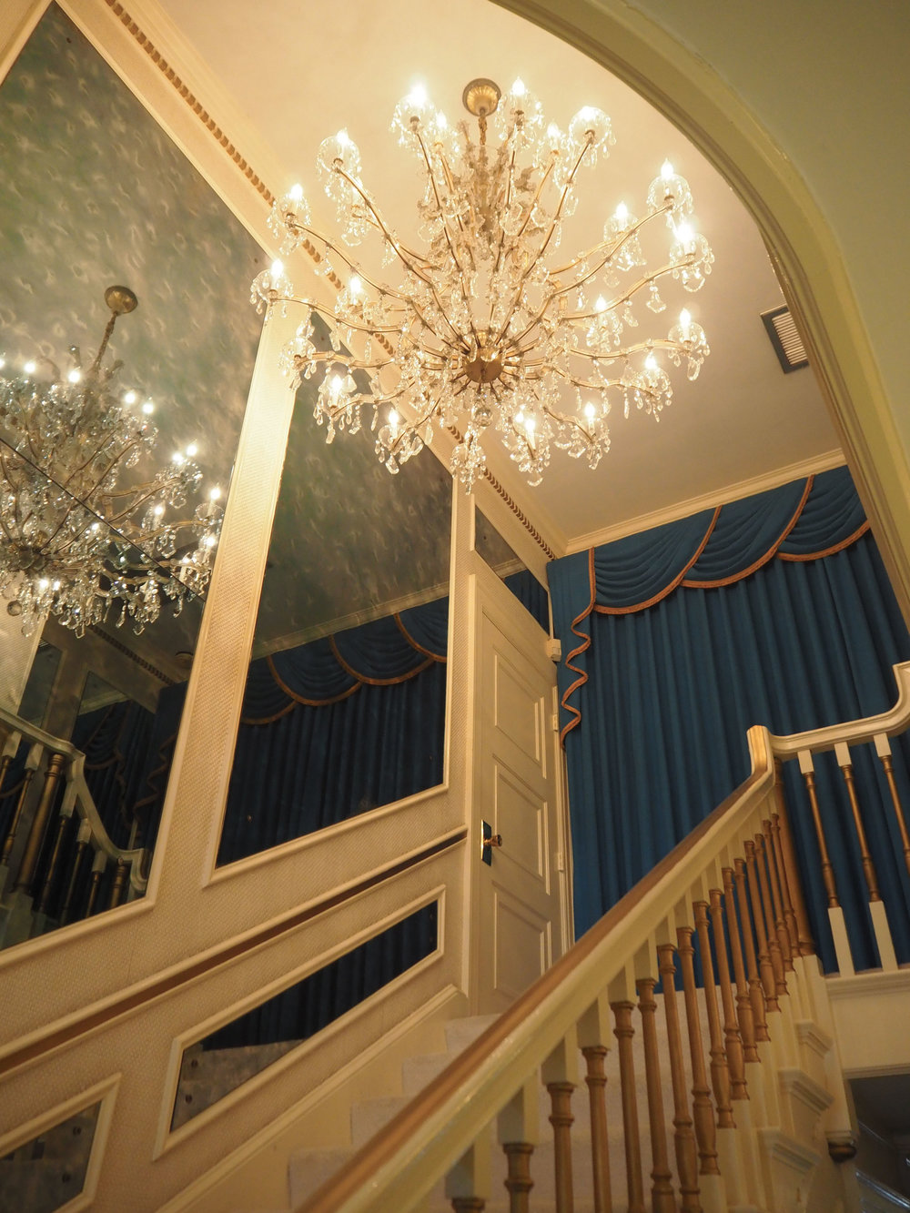 A beautiful chandelier hanging over the grand staircase at Graceland {Elvis Presley's home, in Memphis Tennessee}. To read more and see more pics, click here.