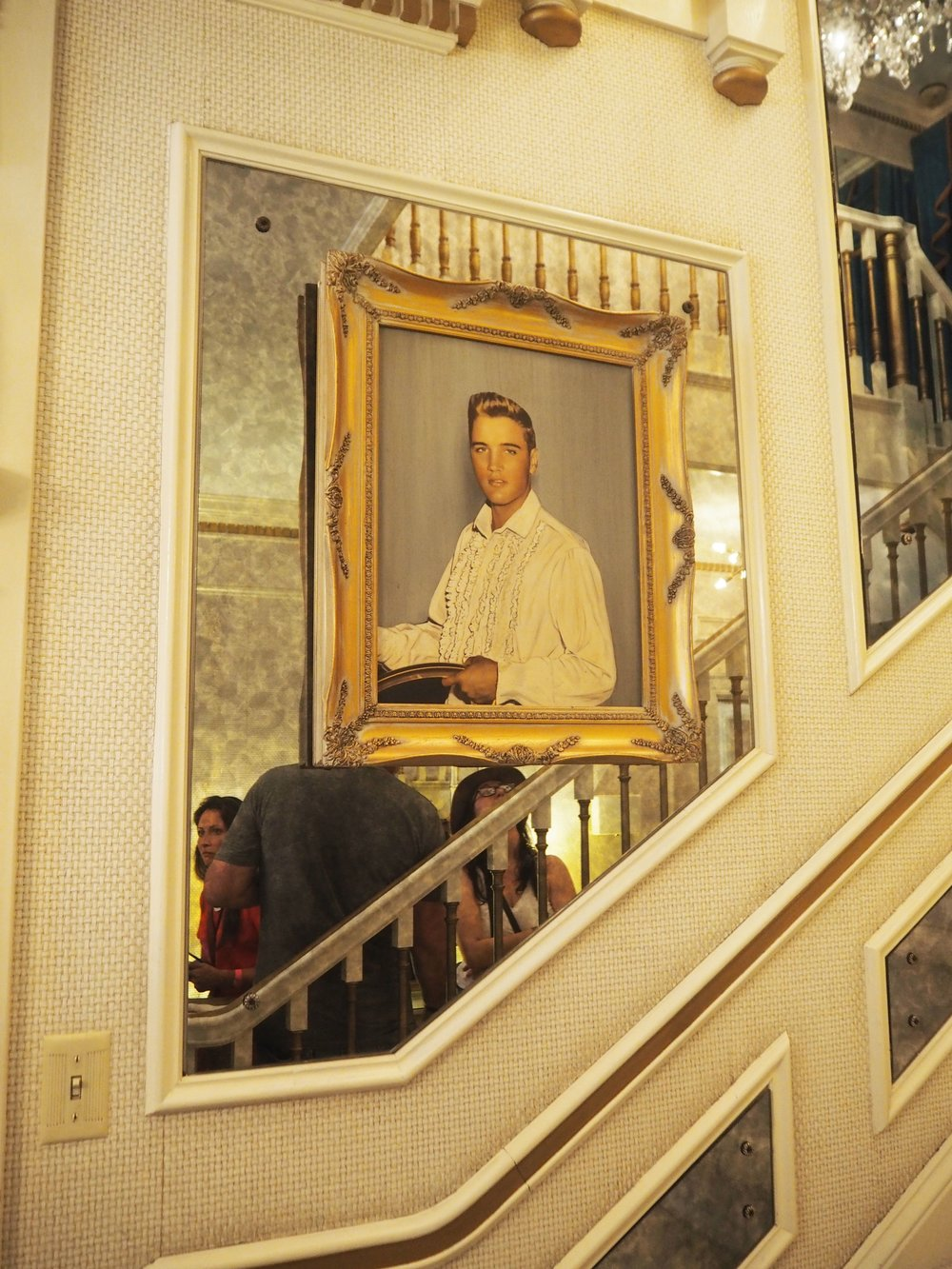 A portrait of a young 22 year old Elvis Presley. The hallway inside Graceland {Elvis Presley's home, in Memphis Tennessee}. To read more and see more pics, click here.