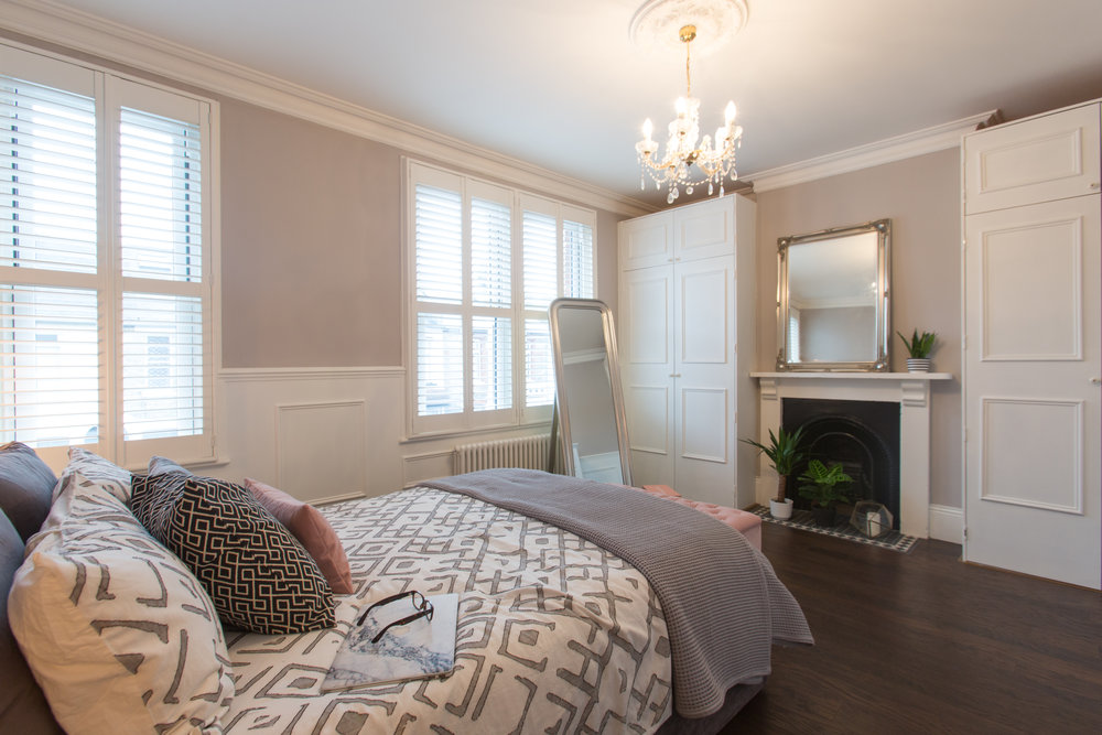 Victorian grey bedroom with panelled walls. Bedding from West Elm.