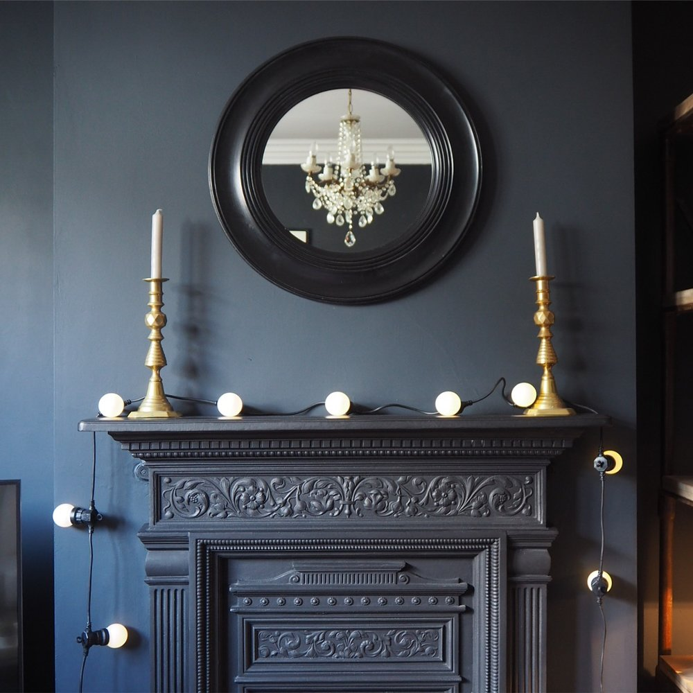 Our dark lounge and cast iron Fireplace