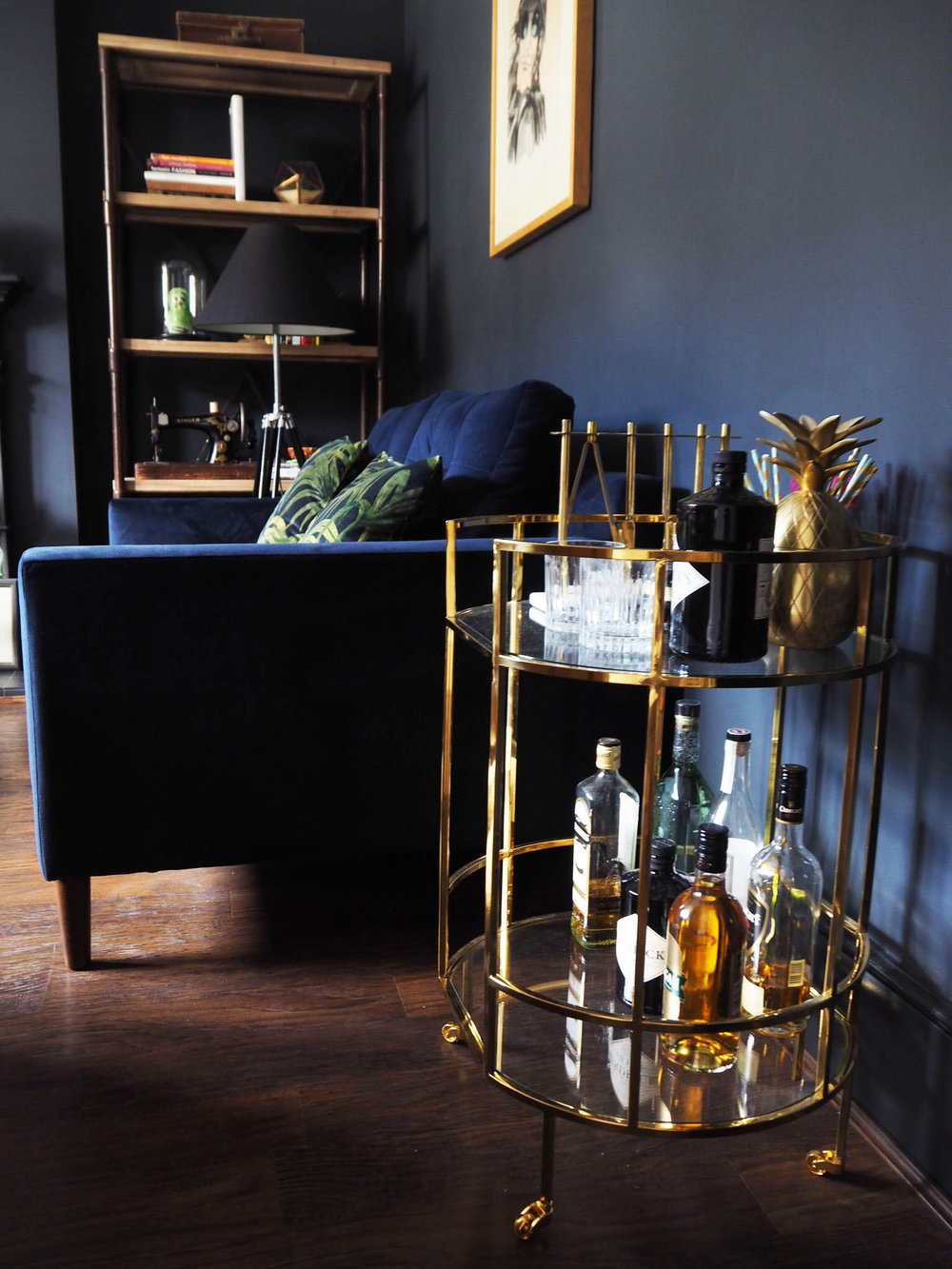 Marks and Spencer Barclay brass drinks trolley and House of Hackney Palmeral velvet cushions and sofa