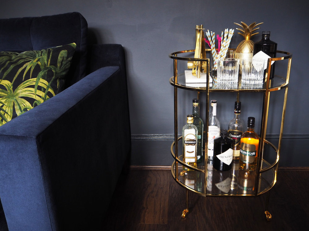 Barclay brass drinks trolley in our dark lounge and House of hackny Palmeral cushions