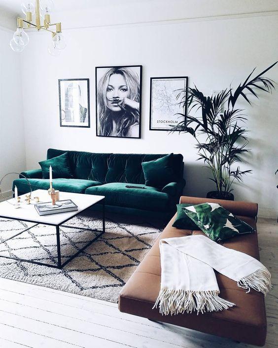 Modern lounge  with a green velvet sofa