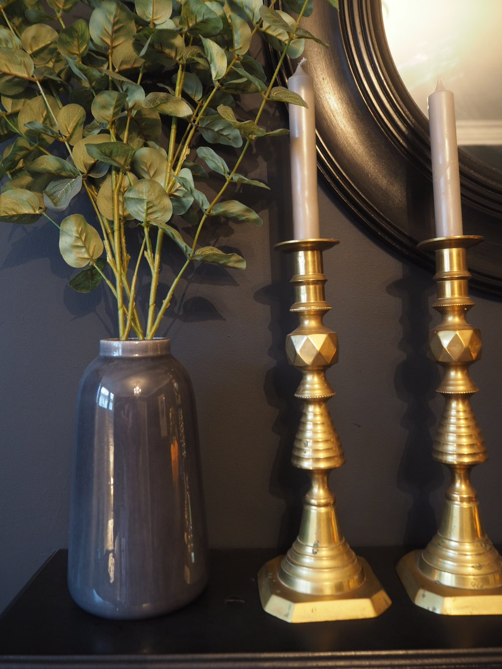 Brass candle sticks and grey/ teal vase and faux flowers
