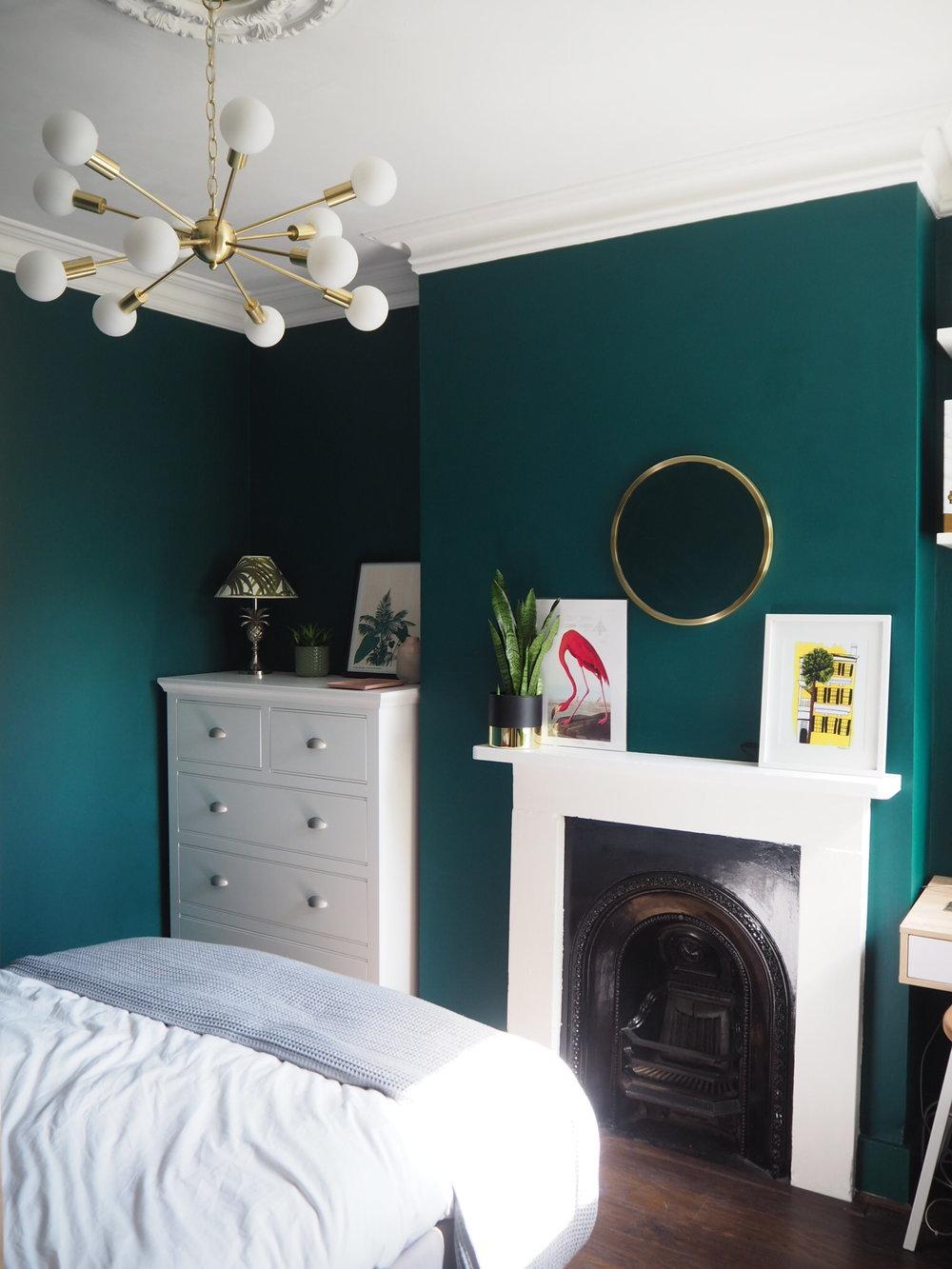 Bird- Flamingo print. £24 from  Cuemars  . Green paint by  Valspar , colour Breathe Deeply. Brass Dexter light,  M&S  £199