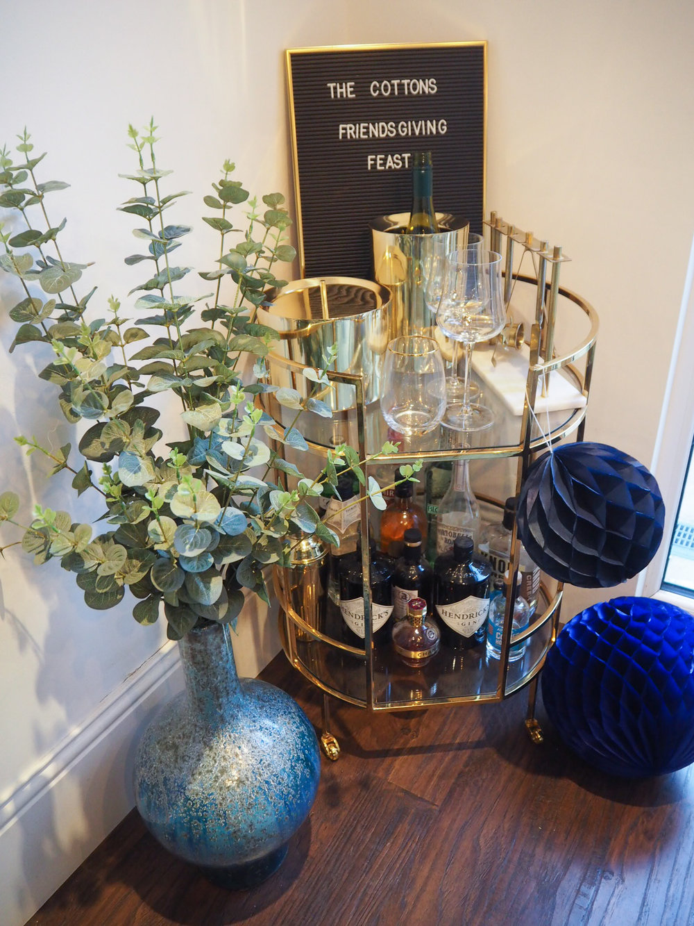 Blue Reactive glaze vase   £79 from West Elm;   Brass ice bucket   £69, from West Elm;   Brass wine cooler    £49  from West Elm