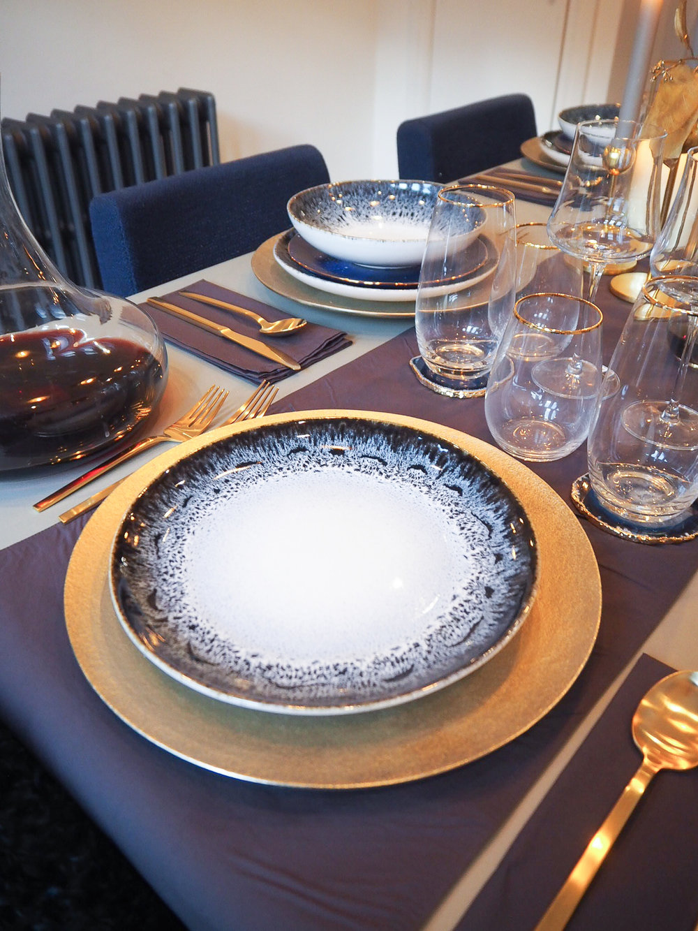 Reactive glaze dinner plate   £12, West Elm;   Metallic charger plate   £29 each, West Elm.