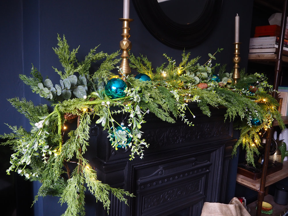 s   nowy pine cone garland   (faux) from The range £14.99;   Luxury Aqua Turquoise Shiny Finish Shatterproof Bauble Range   - Pack of 6 x 80mm £6 From   Christmas Time UK;     candle sticks are antique.