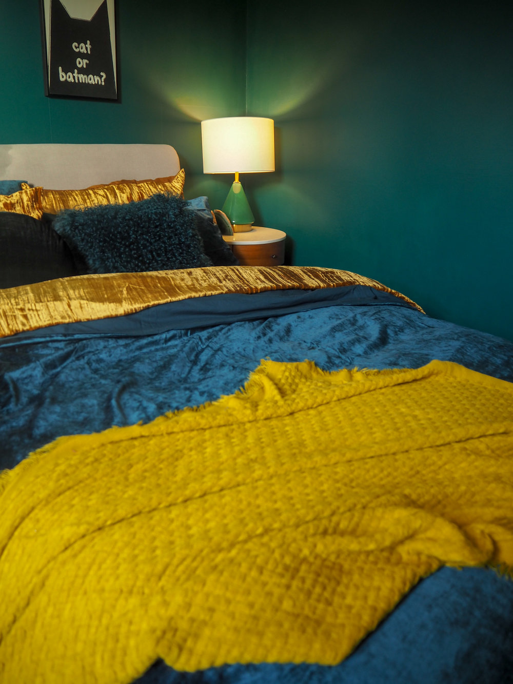 Crinkle Velvet Duvet Cover + Pillowcases   - Golden Oaks £149 from   West Elm   ;    Washed Cotton Lustre Velvet Duvet Cover + Pillowcases - Regal Blue   £149 from   West Elm   ;    Metalized Glass Table Lamp + USB - Small (Green)   £99 from   West Elm  ;   Mongolian Lamb Cushion Covers in teal   £69 from West Elm,   Round Lush Velvet Cushions in Green gables   £39 from   West Elm  ;   Penelope Bedside Table   £349 from   West Elm  ;   Agate Bookends in green   £24 (each) from   West Elm  ; Bed (Old);   Waffle Weave Throw in horseradish   £39 from   West Elm  .