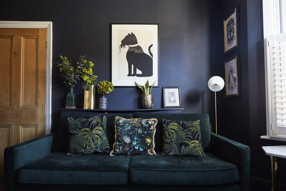 Drake Green velvet sofa   £999,   West Elm    ;    Staggered glass floor lamp    £199,    West Elm   ;  Cushions hand made in   House of hackney   fabric.